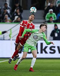 WOLFSBURG, Feb. 18, 2018  Bayern Munich's Thiago Alcantara (L) vies for a header with Wolfsburg's Gian-Luca Itter during a German Bundesliga match between VfL Wolfsburg and Bayern Munich, in Wolfsburg, Germany, on Feb. 17, 2018. Bayern Munich won 2-1. (Credit Image: © Shan Yuqi/Xinhua via ZUMA Wire)