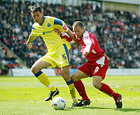 Photo: Chris Ratcliffe.<br />Leyton Orient v Peterborough United. Coca Cola League 2. 29/04/2006.<br />Lee Steele of Orient tries to get away from Phil Bolland of Peterborough.