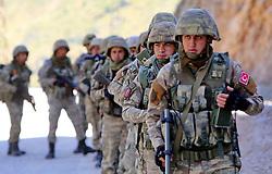 June 21, 2017 - Hakkari, Turkey - June 21, 2017 - Hakkari, Turkey - Turkish soldiers patrols in Yuksekova, in the Hakkari province, near the Turkish-Iraqi-Iranian border, southeastern Turkey,  June 23, 2017. Turkish security forces have killed 53 outlawed Kurdistan Workers' Party (PKK) militants in operations in the eastern and southeastern provinces in the past week, the Turkish General Staff said in a statement on June 23. The statement said 53 militants were killed in the Şırnak, Hakkari, Diyarbakır, Bingöl, Elazığ and Siirt provinces. (Credit Image: © Umit Kozan/Depo Photos via ZUMA Wire)