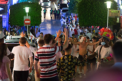 © Licensed to London News Pictures.  03/07/2021. Magaluf, Spain. British football supporters celebrate their victory over Ukraine in semi-final match during the EURO 2020 in Magaluf, Balearic Islands. Photo credit: Marcin Nowak/LNP