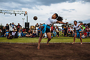 SAN MARTIN DE LAS PIRAMIDES, MEXICO - APRIL 15, 2017: Lizeth Garcia prepares herself to receive and hit with her hips a rubber ball during a tourney of Mesoamerican Ball Game titled Ullamaliztli. A player prepares himself to receive and hit a rubber ball during a tourney of Mesoamerican Ball Game titled Ulamaztli. To withstand the blow of the ball, that weighs 7 pounds, the players protect their hips with bandages and leather belts. Each team has 5 players and the game purpose is to keep the ball inside the play area without touch it with hands or another part of the body, except the hips. Rodrigo Cruz for The New York Times