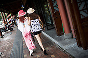 "Chinese girls walk on a street in Chengdu, China, August 12, 2014.<br />   <br /> This picture is part of the series ""Urban Chinese Streets"", a journey on the streets of Chinese cities to discover their modern citizens and habits.      <br /> <br /> © Giorgio Perottino"