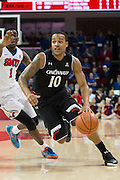 DALLAS, TX - JANUARY 7: Troy Caupain #10 of the Cincinnati Bearcats drives to the basket against the SMU Mustangs on January 7, 2016 at Moody Coliseum in Dallas, Texas.  (Photo by Cooper Neill/Getty Images) *** Local Caption *** Troy Caupain