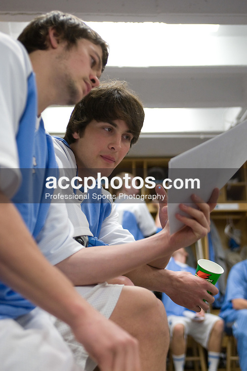 16 February 2008: North Carolina Tar Heels defenseman Kerry McCormick (41) (left) and defenseman Michael Jarvis (8) read a scouting report before a 2-15 win over the Bellarmine Knights at Fetzer Field in Chapel Hill, NC.