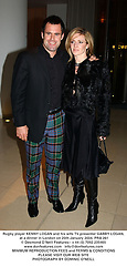 Rugby player KENNY LOGAN and his wife TV presenter GABBY LOGAN, at a dinner in London on 25th January 2004.PRA 261
