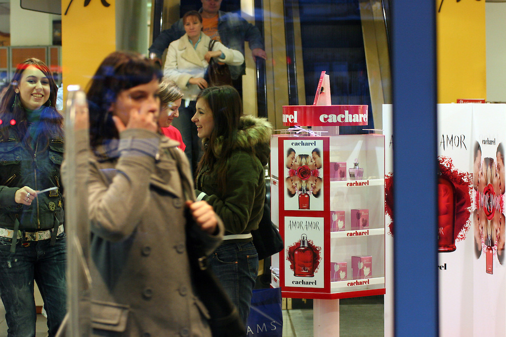 Young women shopping in a perfumery at the Prague Wenceslas Square.