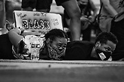 Protestors lay on the ground with their arms behind them during a march in Indianapolis Friday, June 5, 2020 to  protest of the death of George Floyd, who died after being restrained by Minneapolis police officers on Memorial Day. (AJ Mast )