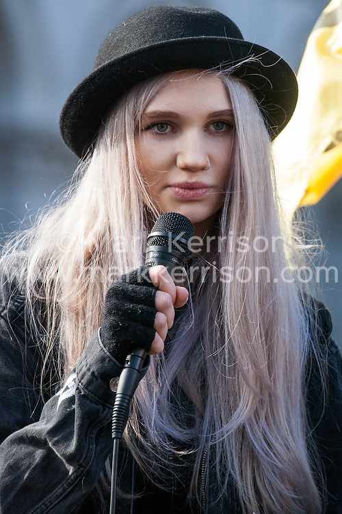 London, UK. 9th March, 2019. Young activists address climate activists from Extinction Rebellion after they poured artificial blood on the ground outside Downing Street as part of an act of civil disobedience named 'The Blood of Our Children' to call on the Government to take immediate steps to combat the current climate and ecological emergency.