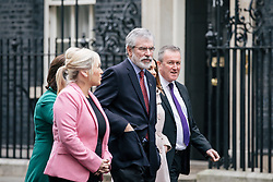 © Licensed to London News Pictures. 21/11/2017. London, UK. Sinn Fein Leader GERRY ADAMS (C) leaves 10 Downing Street after meeting with Prime Minister Theresa May. Photo credit: Rob Pinney/LNP