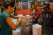 A meal made with rice and sausage is served in Crackland near Manguinhos shantytown, Rio de Janeiro. The majority of evangelism team is composed by crack dependents in advanced recovering stage.