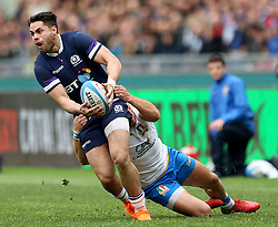 Scotland's Sean Maitland is tackled during the NatWest 6 Nations match at the Stadio Olimpico, Rome.