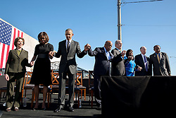 President Barack Obama and First Lady Michelle Obama join former First Lady Laura Bush, Rep. John Lewis, D-Ga., and former President George W. Bush for a prayer during the event to commemorate the 50th Anniversary of Bloody Sunday and the Selma to Montgomery civil rights marches, at the Edmund Pettus Bridge in Selma, Ala., March 7, 2015. (Official White House Photo by Pete Souza)<br /> <br /> This official White House photograph is being made available only for publication by news organizations and/or for personal use printing by the subject(s) of the photograph. The photograph may not be manipulated in any way and may not be used in commercial or political materials, advertisements, emails, products, promotions that in any way suggests approval or endorsement of the President, the First Family, or the White House.