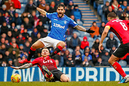Rangers Daniel Candeias avoids the challenge from Gary Dicker of Kilmarnock during the Ladbrokes Scottish Premiership match between Rangers and Kilmarnock at Ibrox, Glasgow, Scotland on 16 March 2019.