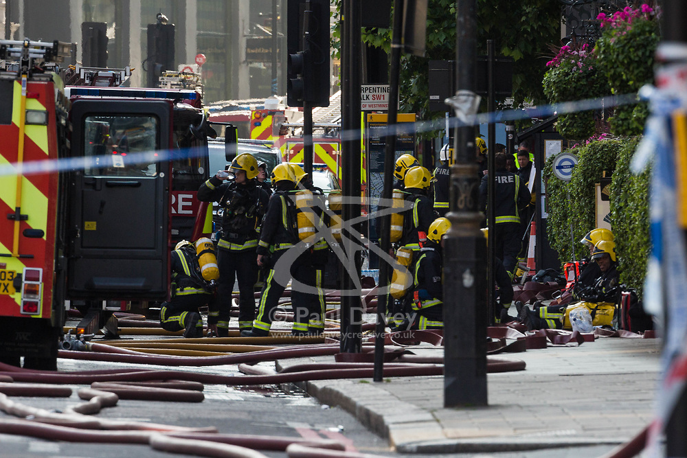 A huge fire has broken out at a luxury hotel in central London.  See NATIONAL story NNFIRE.  Plumes of smoke could be seen rising from the five-star Mandarin Oriental in Knightsbridge after firefighters were called just before 16:00.  London Fire Brigade, which has dispatched about 100 firefighters and 15 engines, said it received more than 35 calls about the incident.  A spokesperson said the cause of the fire, in William Street, was not yet known.  Knightsbridge has been closed between Sloane Street and Grosvenor Place. There are no reports of any injuries, the fire service said. . London, June 06 2018.