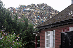 © Licensed to London News Pictures. 20/08/2015<br /> A mountain of waste still towers over local residents in St Pauls Cray,Orpington,Kent.  TODAY (20.08.2015)<br /> The residents of Cornwall Drive are still having to put up with a stinking smell,rats and fires coming from the  Waste4fuel site which is based at the end of the cul-de-sac.     The waste pile which is 40ft high can be clearly seen from Sidcup by-pass A20 and Crittalls Corner roundabout and is the first landmark visitors to the area are greeted with.<br /> <br /> <br /> (Byline:Grant Falvey/LNP)