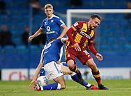 Paul Taylor of Bradford City is tackled by Jordan Flores of Chesterfield during the EFL Trophy match between Chesterfield and Bradford City at the b2net stadium, Chesterfield, England on 29 August 2017. Photo by Paul Thompson.