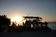 Caye Caulker island ocean view and jetee at dusk, silhouettes and afternon light. Belize.