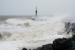© London News Pictures. 30/12/2015. Aberystwyth, UK.<br /> At high tide the winds of Storm Frank, the sixth named storm of the season,  bring huge waves to batter the harbour and promenade  at Aberystwyth on the Cardigan Bay coast, West Wales. Storm Frank, is expected to bring gales force winds gusting up to 70 or 80mph in the north of England and Scotland, and more heavy rain falling on areas that have already suffered flooding. Photo credit: Keith Morris/LNP