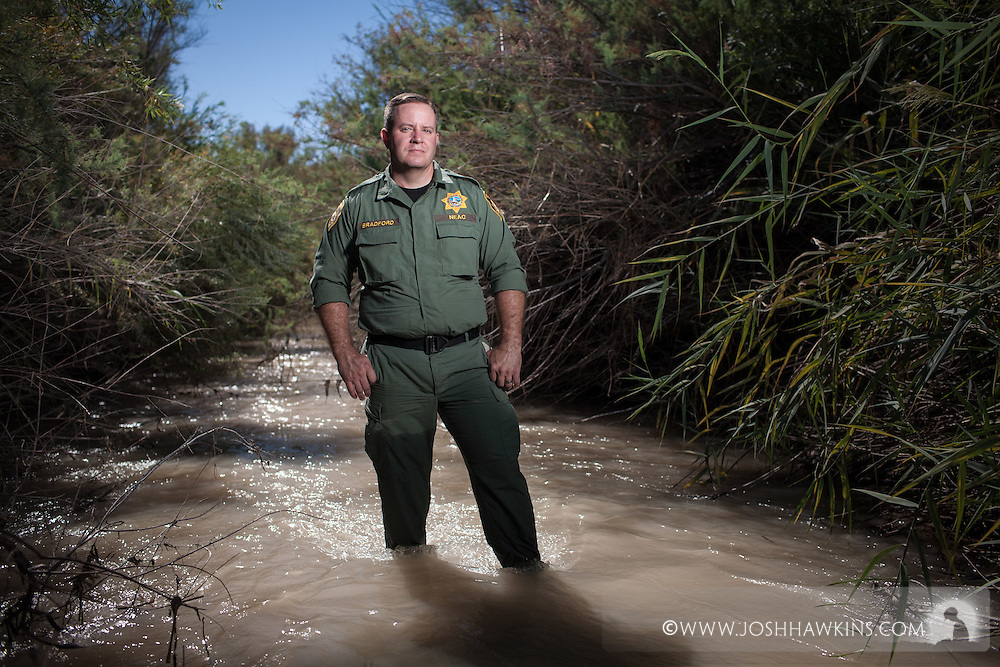While on patrol near Overton, Officer Nathan Bradford received a call that a driver had lost control of <br /> <br /> her vehicle, launching it over a twenty foot embankment and into the Muddy River. Officer Bradford <br /> <br /> arrived on scene to find the overturned car quickly sinking into the soft river bottom with an injured <br /> <br /> elderly woman and her dog trapped inside. He immediately shed his heavy gear and jumped into the <br /> <br /> river. While chest-deep and sinking in the mud, he managed to pry open the car door, lift the woman <br /> <br /> and her dog up and out to another officer standing on top of the car, and save their lives.IMG_1479.CR2<br /> 8/29/2014  --  10:23:53