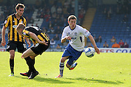 Bury's Danny Mayor ® breaks past Southend's Marc Laird and Will Atkinson . Skybet football league two match, Bury v Southend Utd at Gigg Lane in Bury, England on Sat 21st Sept 2013. pic by David Richards/Andrew Orchard sports photography