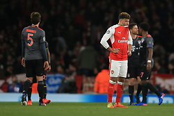 7 March 2017 - UEFA Champions League - (Round of 16) - Arsenal v Bayern Munich - A dejected Alex Oxlade-Chamberlain of Arsenal looks on as Bayern celebrate their 5th goal of the night - Photo: Marc Atkins / Offside.