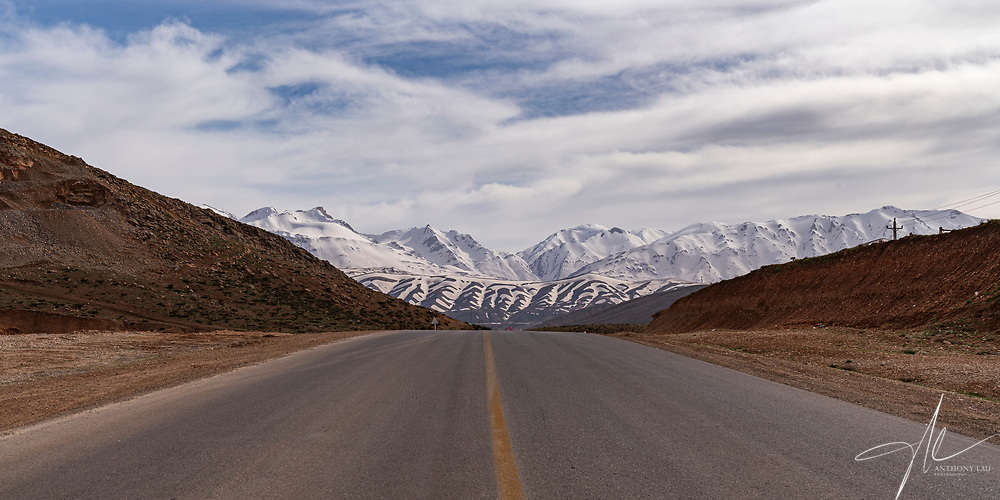 Contrasting pattern of mountain ranges as seen in the highway into Chelgerd of Iran.