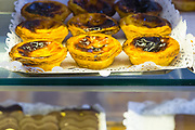 Pastel de Nata famous Portugese custard tarts on sale in Confeitaria Nacional pastry shop and cafeteria in Praça da Figueira, Portugal