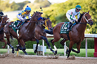 HOT SPRINGS, AR - MAY 02:  Jockey Martin Garcia rides #5 Nadal to the lead past Jockey Florent Geroux on #11 Wells Bayouto during the 84th running of The Arkansas Derby Grade 2 at Oaklawn Racing Casino Resort on Derby Day during the Covid-19 Pandemic on May 2, 2020 in Hot Springs, Arkansas. (Photo by Wesley Hitt/Getty Images)