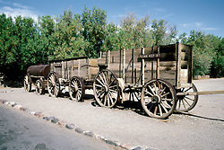 CA: Death Valley National Park, Furnace Creek Ranch, Harmony Borax Works, old borax mining wagons               .Photo by Lee Foster, lee@fostertravel.com, www.fostertravel.com, (510) 549-2202.Image: cadeat211
