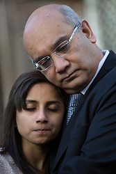 © licensed to London News Pictures. London, UK. 15/12/2012. The husband Ben Barboza (left) and The daughter Lisha (centre), of nurse Jacinta Saldanha talking to the media outside Westminster Cathedral in London after a memorial service with Keith Vaz (right) held for Jacinta Saldanha who committed suicide. Photo credit: Tolga Akmen/LNP