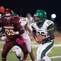 Cody Jake carries the ball for the Thoreau Hawks against Tohatchi Cougars Friday Oct. 5, 2018 in Tohachi.