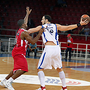 Anadolu Efes's Ermal KURTOGLU (R) during their Two Nations Cup basketball match Anadolu Efes between Olympiacos at Abdi Ipekci Arena in Istanbul Turkey on Sunday 02 October 2011. Photo by TURKPIX