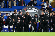 Eddie Howe, the Bournemouth manager is congratulated by his staff after the final whistle from the dugout. Barclays Premier league match, Chelsea v AFC Bournemouth at Stamford Bridge in London on Saturday 5th December 2015.<br /> pic by John Patrick Fletcher, Andrew Orchard sports photography.