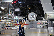 SAN LUIS POTOSI, MEXICO - JUNE 13, 2019: A worker at the BMW vehicles production plant in Mexico.