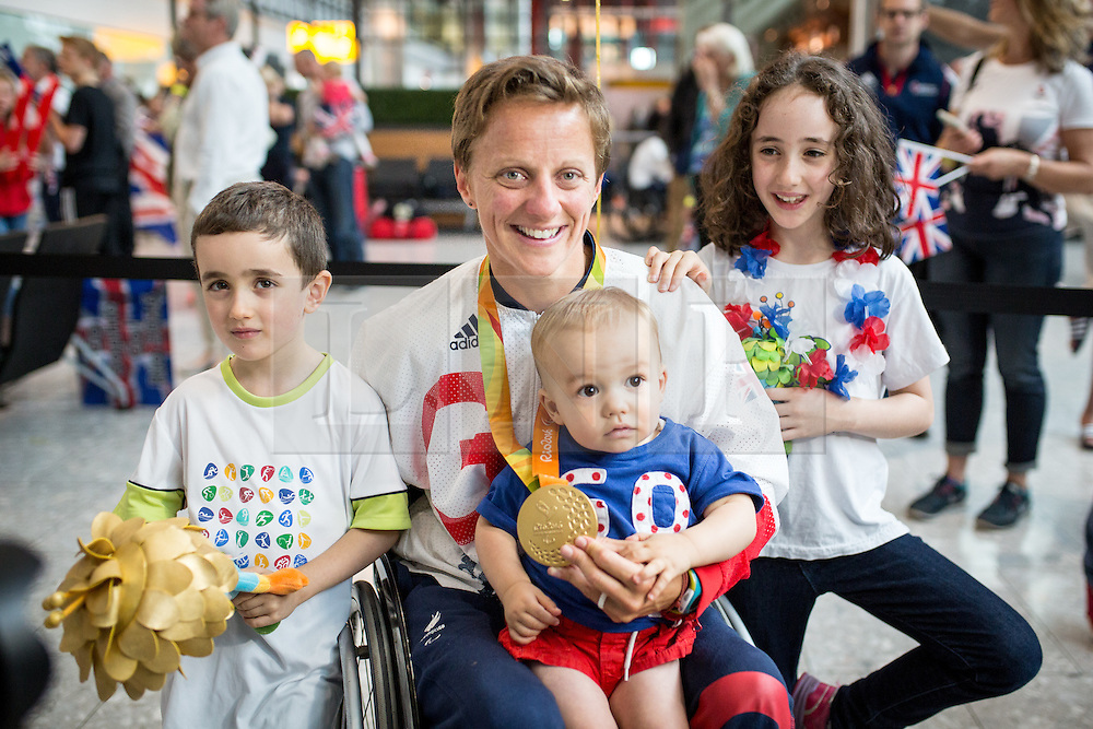 © Licensed to London News Pictures. 20/09/2016. London, UK. Team GB Paralympian EMMA WIGGS arrives to meet her children at terminal 5 of London Heathrow Airport after flying on British Airways flight BA2016. Wiggs won gold in KL2 classification of paracanoe. Team GB finished second in the Paralympics medals table with 147 medals beating their total of 120 at London 2012. Photo credit : Tom Nicholson/LNP