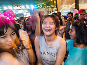 31 DECEMBER 2013 - BANGKOK, THAILAND:  Thais count down the final minutes of 2013 at the New Year's Eve Party in Ratchaprasong Intersection in Bangkok. Hundreds of thousands of people pack into the Ratchaprasong Intersection in Bangkok for the city's annual New Year's Eve countdown. Many Thais go the Erawan Shrine and Wat Pathum Wanaram near the intersection to pray and make merit.    PHOTO BY JACK KURTZ