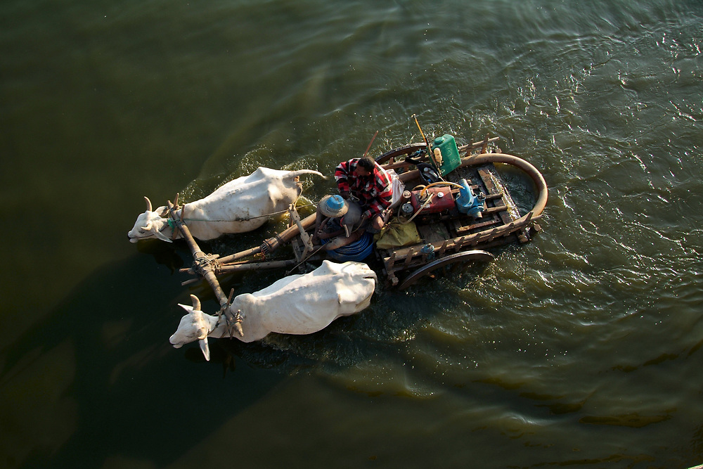 Farmers crossing the Taungthaman Lake near Amarapura in Myanmar.<br /> Photo by Lorenz Berna