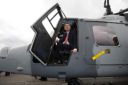 © London News Pictures. 11/07/2012. Farnborough, UK. Defence Secretary Philip Hammond sat in a wildcat after officially receiving first Wildcat helicopters from AgustaWestland on behalf of the armed forces on day three of the Farnborough International Airshow, in Farnborough, Hampshire, UK on July 9, 2012. FIA is a seven-day international trade fair for the aerospace industry which is held every two years at Farnborough Airport . Photo credit: Ben Cawthra/LNP.