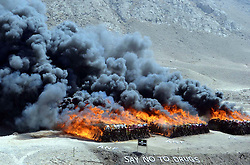 October 20, 2016 - Pakistan - QUETTA, PAKISTAN, OCT 20: View of burning pile of confiscated drugs during the .incineration ceremony of seized illegal drugs, held at Kuch Mor located on Quetta Cantonment .area on Thursday, October 20, 2016. The law enforcement agency burnt a large quantity of .narcotics and alcohol seized in different parts of the province. (Credit Image: © PPI via ZUMA Wire)