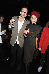 GEORGE SITWELL and his wife MARTHA DE BLANK at a party to celebrate the publication of Cloak & Dagger Butterfly by Amanda Eliasch held at the Soho Revue Bar, London on 17th November 2008.