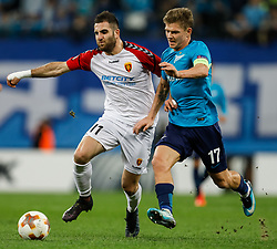 November 23, 2017 - Saint Petersburg, Russia - Oleg Shatov (R) of FC Zenit Saint Petersburg and Tigran Barseghyan of FK Vardar vie for the ball during the UEFA Europa League Group L match between FC Zenit St. Petersburg and FK Vardar at Saint Petersburg Stadium on November 23, 2017 in Saint Petersburg, Russia. (Credit Image: © Mike Kireev/NurPhoto via ZUMA Press)