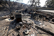 A home damaged by a brushfire, Sunday, Sept. 3, 2017, in Burbank, Calif. Several hundred firefighters worked to contain a blaze that chewed through brush-covered mountains, prompting evacuation orders for homes in Los Angeles, Burbank and Glendale.(Photo by Ringo Chiu)<br /> <br /> Usage Notes: This content is intended for editorial use only. For other uses, additional clearances may be required.
