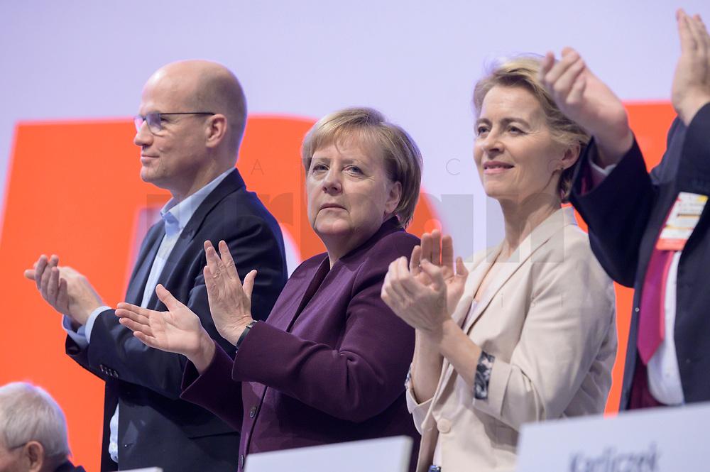 22 NOV 2019, LEIPZIG/GERMANY:<br /> Ralph Brinkhaus, CDU, Vorsitzender der CDU/CSU Bundestagsfraktion, Angela Merkel, CDU, Bundeskanzlerin, Ursula von der Leyen, CDU, gewaehlte Praesidentin der Europaeischen Kommission, (v.L.n.R.), applaudieren nach der rede von K ramp-karrenabauer, CDU Bundesparteitag, CCL Leipzig<br /> IMAGE: 20191122-01-152<br /> KEYWORDS: Parteitag, party congress, Applaus, applaudiren, klatschen