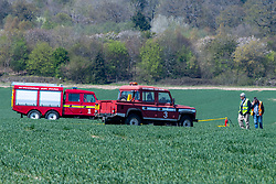 © Licensed to London News Pictures. 26/04/2021. High Wycombe, UK. Emergency services in a field following a crash at Wycombe Air Park, also known as Booker Airfield. the incident occurred at approximatly 10:30 BST when a plane crashed through bushes at the end of the runway coming to rest in a field. Photo credit: Peter Manning/LNP