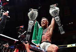 "Nov 13, 2016 - New York, New York, U.S. - Eddie Alvarez (red gloves) vs. Conor ""The Notorious"" McGregor (blue gloves) during UFC 205 at Madison Square Garden. (Credit Image: © Jason Silva via ZUMA Wire)"