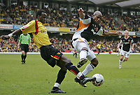 Photo: Lee Earle.<br /> Watford v Hull. Coca Cola Championship. 30/04/2006. Watford's Al Bangura (L) battles with Alton Thelwell.