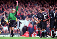 Referee Rob Harris shows the red card to Aston Villas Lee Hendrie (17) after his 2nd bookable offence. Arsenal 1:0 Aston Villa, F.A.Carling Premiership, 13/10/2000. Credit Colorsport / Stuart MacFarlane.