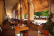 The French built Liston Esplanade  Cafes,  Kerkya, Corfu City, Greek Ionian Islands .<br /> <br /> If you prefer to buy from our ALAMY PHOTO LIBRARY  Collection visit : https://www.alamy.com/portfolio/paul-williams-funkystock/corfugreece.html <br /> <br /> Visit our GREECE PHOTO COLLECTIONS for more photos to download or buy as wall art prints https://funkystock.photoshelter.com/gallery-collection/Pictures-Images-of-Greece-Photos-of-Greek-Historic-Landmark-Sites/C0000w6e8OkknEb8
