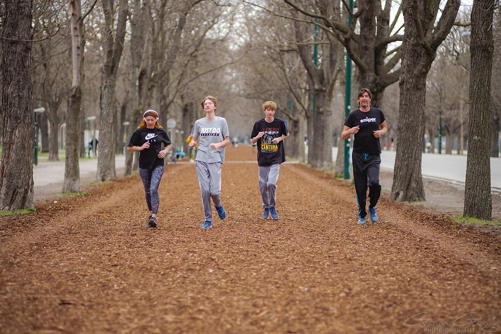 Four people jogging in the park, Prater Park, Vienna, Austria