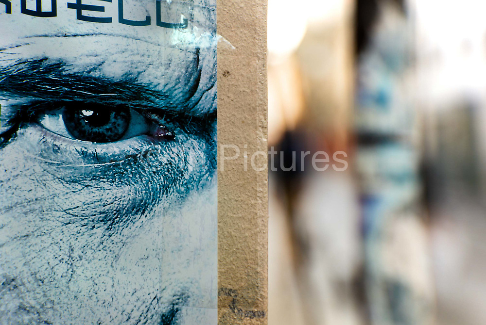Poster with staring eye in the Bastille area of Paris, France.